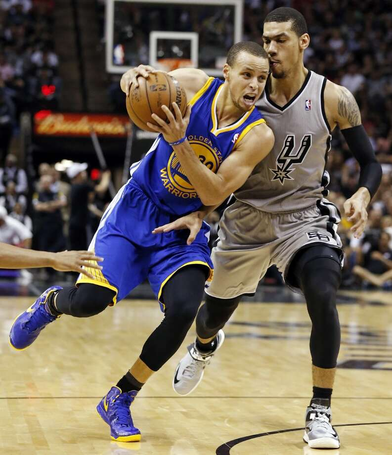 The Warriors' Stephen Curry looks for room around the Spurs' Danny Green during first half action of Game 5 in the NBA Western Conference semifinals Tuesday May 14, 2013 at the AT&T Center. Photo: Edward A. Ornelas, San Antonio Express-News