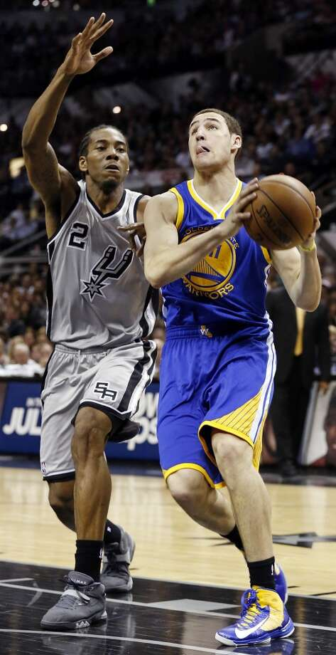 The Warriors' Klay Thompson drives around the Spurs' Kawhi Leonard during first half action of Game 5 in the NBA Western Conference semifinals Tuesday May 14, 2013 at the AT&T Center. Photo: Edward A. Ornelas, San Antonio Express-News