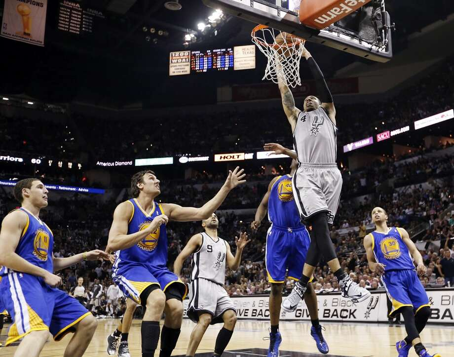 The Spurs' Danny Green goes up for a dunk over the Warriors' Klay Thompson (from left),  Warriors' Andrew Bogut,  Warriors' Harrison Barnes and Warriors' Stephen Curry during second half action of Game 5 in the NBA Western Conference semifinals Tuesday May 14, 2013 at the AT&T Center. The Spurs won 109-91. Photo: Edward A. Ornelas, San Antonio Express-News