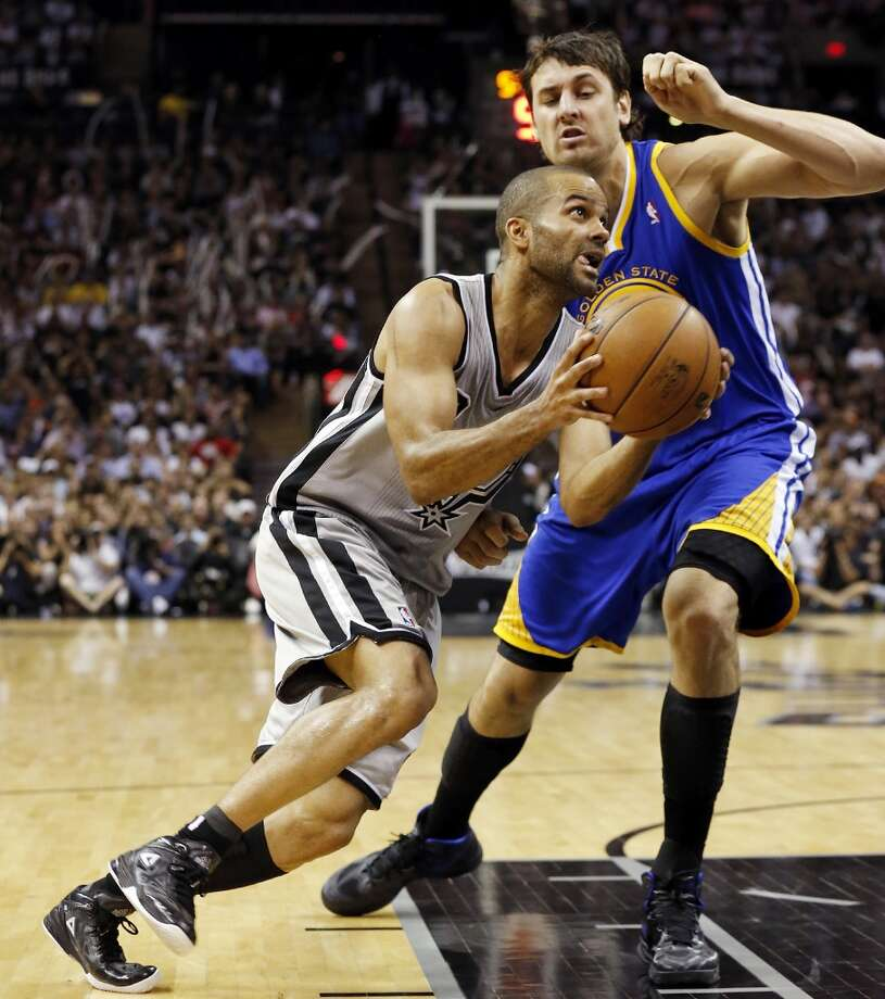 The Spurs' Tony Parker drives around the Warriors' Andrew Bogut during second half action of Game 5 in the NBA Western Conference semifinals Tuesday May 14, 2013 at the AT&T Center. The Spurs won 109-91. Photo: Edward A. Ornelas, San Antonio Express-News