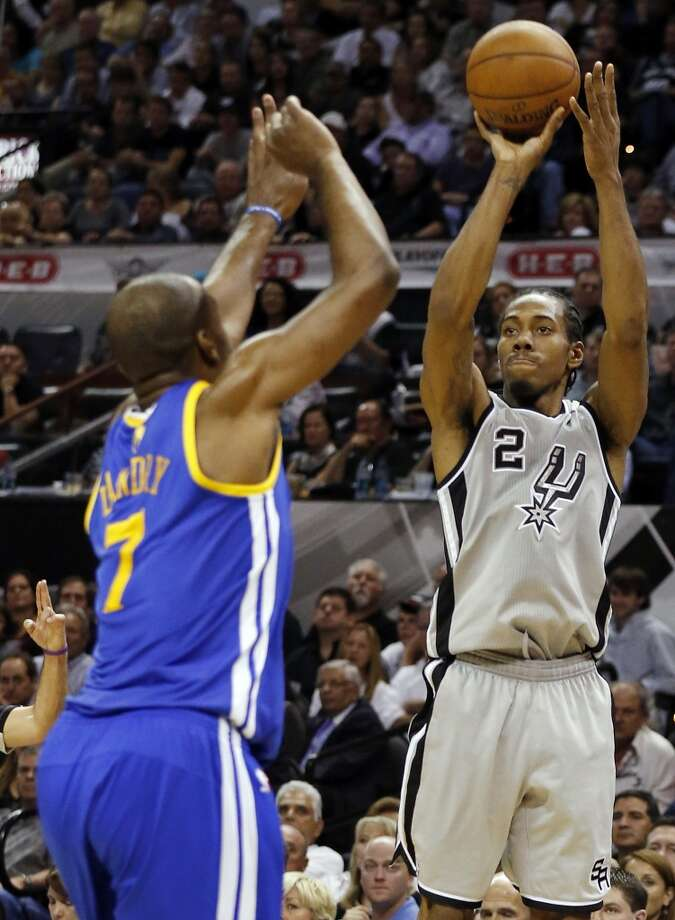 The Spurs' Kawhi Leonard shoots around the Warriors' Carl Landry during second half action of Game 5 in the NBA Western Conference semifinals Tuesday May 14, 2013 at the AT&T Center. The Spurs won 109-91. Photo: Edward A. Ornelas, San Antonio Express-News