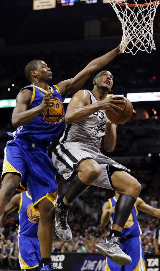 The Spurs' Boris Diaw shoots around the Warriors' Harrison Barnes during second half action in Game 5 of the NBA Western Conference semifinals Tuesday May 14, 2013 at the AT&T Center. Diaw was fouled on the play. The Spurs won 109-91. Photo: Edward A. Ornelas, San Antonio Express-News