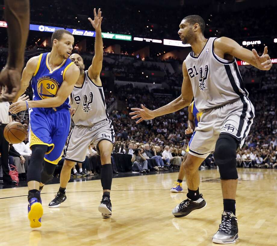 The Warriors' Stephen Curry pass around the Spurs' Tony Parker and Tim Duncan during first half action of Game 5 in the NBA Western Conference semifinals Tuesday May 14, 2013 at the AT&T Center. Photo: Edward A. Ornelas, San Antonio Express-News