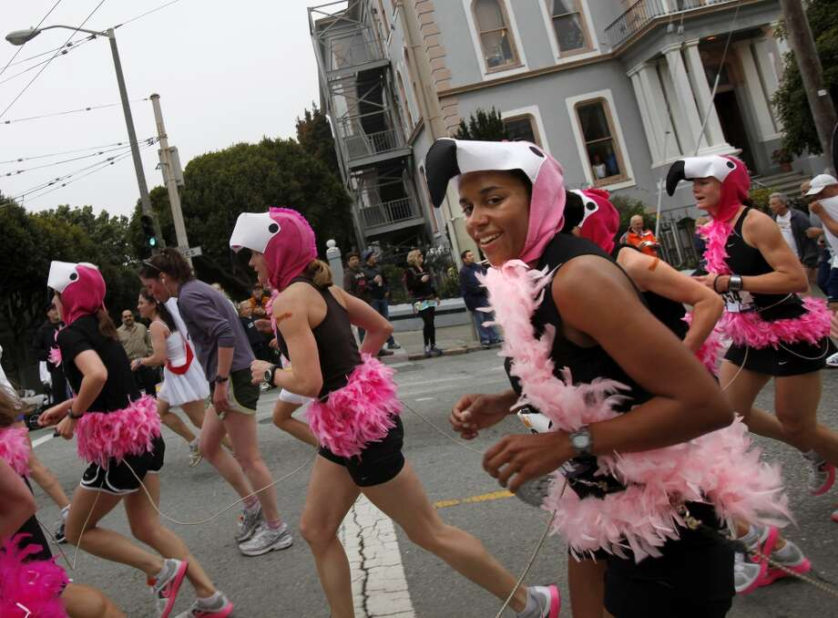 The flamingos were pink and very fast as they raced up Hayes Street. Thousands took place in the 99th annual ING Bay to Breakers event  Sunday morning May 16, 2010 in San Francisco, Calif.