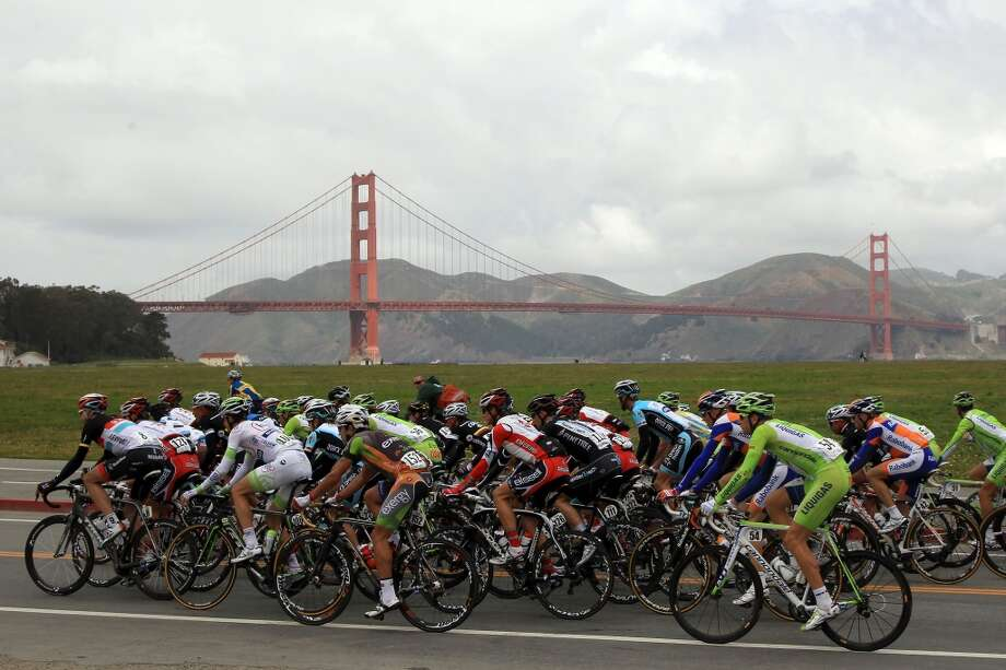 SAN FRANCISCO, CA - MAY 14:  The peloton rides past the Golden Gate Bridge during stage two of the Amgen Tour of California from San Francisco to Santa Cruz on May 14, 2012 in San Francisco, California.  (Photo by Doug Pensinger/Getty Images)