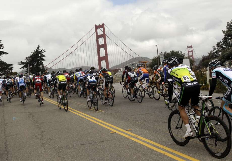 The peloton rides next to the Golden Gate bridge during Stage 2 of the Tour of California cycling race on Monday, May 14, 2012 in San Francisco. (AP Photo/Marcio Jose Sanchez)