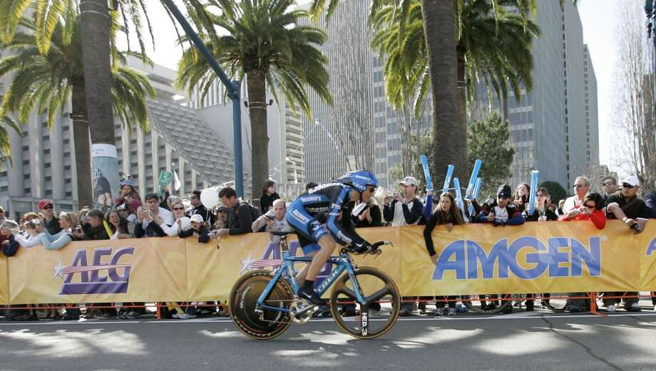 Ivan Basso of the Discovery Channel Pro Cycling Team heads down the Embarcadero past screaming race fans. Prologue stage of the 2007 Amgen Tour of California, a 650 bicycle race from San Francisco to Long Beach, California. Eighteen teams and 144 riders will participate in the 8 day race through California. Today's stage on February 18, 2007 is the individual time trial where the racers race against the clock on a 1.9 mile course from the Embarcadero to Coit Tower. Photo by Michael Maloney / San Francisco Chronicle  ***Ivan Basso  Ran on: 02-19-2007 {triangle} Levi Leipheimer of Santa Rosa, who clocked the best time, pedals the last 50 yards to the finish line at Coit Tower (in background).