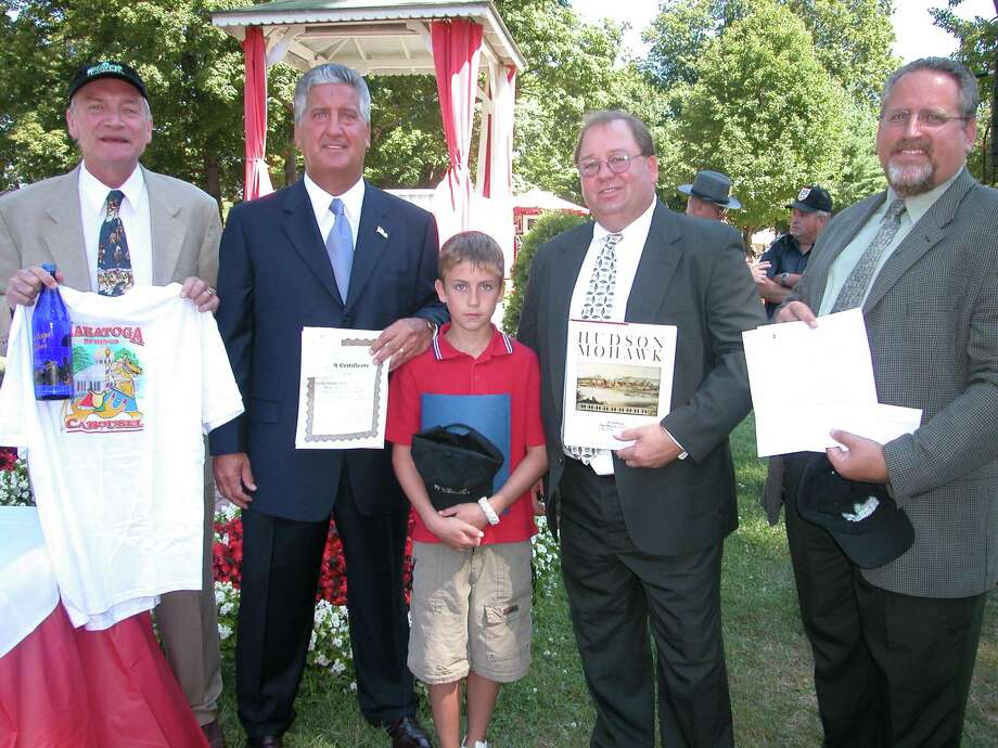 Mayors bearing gifts in the paddock on Wednesday, Aug. 21, 2002, and betting on the outcome of Saturday's Travers, included, from left, Ken Klotz of Saratoga Springs, Jerry Jennings of Albany, Mark Pattison and son, Edward, 11, of Troy, and Al Jurczynski of Schenectady. Wednesday was Albany Day at the track, and Mayor Jennings later presented the trophy to the winner of the Albany handicap. (MARIA McBRIDE BUCCIFERRO/SPECIAL TO THE TIMES UNION)