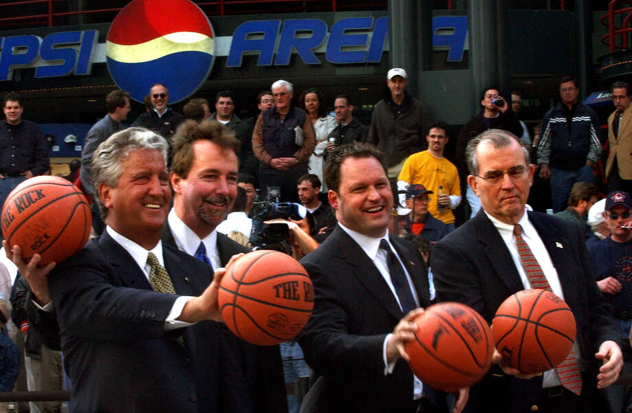 Times Union staff photo by Cindy Schultz -- Albany officials pose for a photo during the kick off of the NCAA Basketball Fan Fest on Friday, March 28, 2003, outside the Pepsi Arena in Albany, N.Y. From left are Mayor Jerry Jennings, Pepsi Arena general manager Bob Belber, Key Bank president Tom Geisel, and Albany County executive Michael Breslin.  Photo: CINDY SCHULTZ, DG / ALBANY TIMES UNION