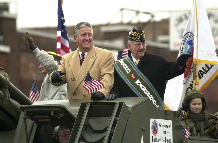 Times Union photo by STEVE JACOBS, 11/1103, Albany,NY--  VET PARADE -- Albay City Mayor Jerry Jennings,left,and  Grand Marshall Richard Marowitz ride atop a tank and waves to the crowd during the Veteran Day Parade, Tuesday, November 11,2003 (for story) 5 of 5 photos Photo: STEVE JACOBSS, DG / TIMES UNION