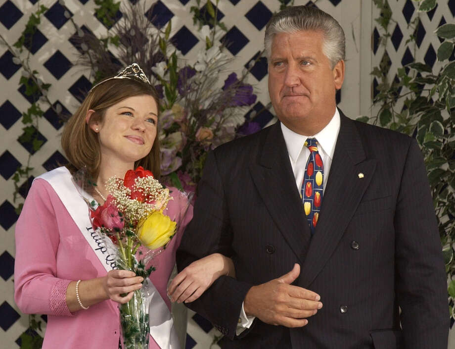 TIMES UNION STAFF PHOTO WILL WALDRON--Meredith Rose basks in a moment of glory after being crowned Tulip Queen 2004, while being is escorted by Mayor Jerry Jennings, Saturday May 8 2004. Photo: WILL WALDRON, ALBANY TIMES UNION / ALBANY TIMES UNION