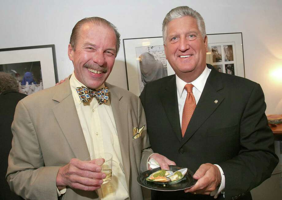 Albany, NY - May 7, 2007 - (Photo by Joe Putrock/Special to the Times Union) - Albany Mayor, Jerry Jennings(right), serves up a plate of muscles from the Café Capriccio table to Chet Opalka(left) at A Grand Evening - A Taste of Albany. Opalka said no one cooks up muscles like 'maestro' jim Rua, owner of cafe Capriccio. Photo: Joe Putrock, Joe Putrock/Special To The Times / The Albany Times Union