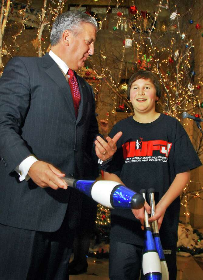 "Times Union staff photo by John Carl D'Annibale:   Albany Mayor Jerry Jennings,left, and   ""The Amazing Blazing Jug gling Johnny"" , 13-year-old Johnny Carlito of Malta,during a  City Hall news conference Tuesday December 4, 2007, announcing the 2nd annual Albany WinterFestival to be held on Saturday December 29.  Photo: John Carl D'Annibale, Albany Times Union / Albany Times Union"