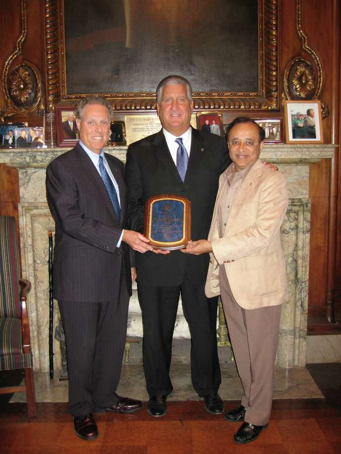 Statewide contest for the Best Tasting Drinking Water in NY State was won by the City of Albany. Manoj Ajmera (far right), the organizer of the contest presented the Winner's plaque to Mayor Jerry Jennings at the Mayor's office. On far left is Robert Cross, Water Commissioner for the city shows the pride for his water team.