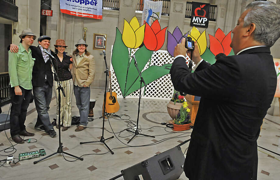 Albany Mayor Jerry Jennings takes a photo of the group Railbird at the unveiling ceremony of the new Tulip Festival logo at Albany Hall in Albany, NY on April 16, 2009. Railbird will be performing at the Tulip Festival on Saturday May 9th on the Local 518 stage at the Washington Park lakehouse. Photo: LORI VAN BUREN, Times Union / 00003306A
