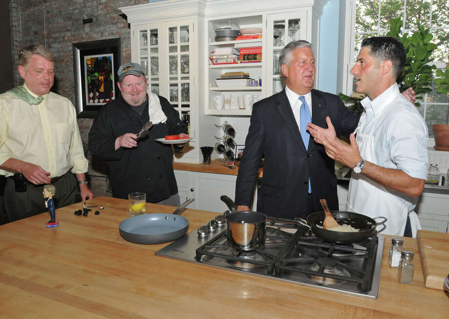 Matt Baumgartner, right, and Steve Barnes, second from left, cook for Mayors Brian Stratton, left, and Jerry Jennings at Matt's loft in Albany, NY on August 19, 2009. Photo: LORI VAN BUREN/TIMES UNION, TIMES UNION / 00005159A