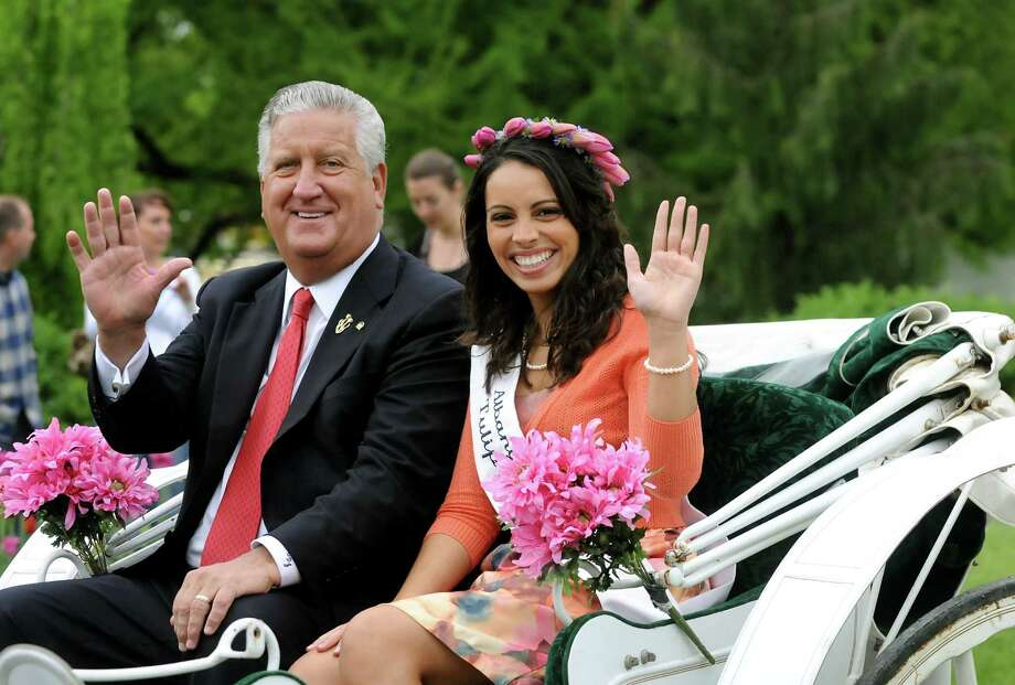 Mayor Jerry Jennings, left, rides in a horse-drawn carriage with the 2009 Tulip Queen Juliana Hernandez during the Tulip Festival on Saturday, May 8, 2010, at Washington Park in Albany, N.Y.  (Cindy Schultz / Times Union) Photo: CINDY SCHULTZ, ALBANY TIMES UNION / 00008573A