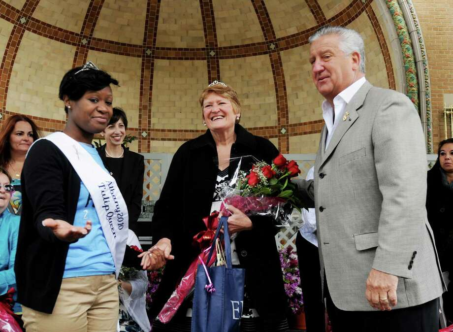 L-R: Mishka Gilkes, 22, who was crowned yesterday as the 2010 Tulip Queen presents the Mother of the Year, Diane Allen, center, of Colonie, at the moment she was announced as the 2010 Albany Tulip Festival Mother of the Year, with Albany City Mayor Jerry Jennings, at the amphitheater stage outside the Lakehouse at Washington Park in Albany, NY.  The Albany Tulip Festival is traditionally held on Mother's Day Weekend, and this marks the 12th year the Mother of the Year has been selected. Photo: LUANNE M. FERRIS, TIMES UNION / 00008574A