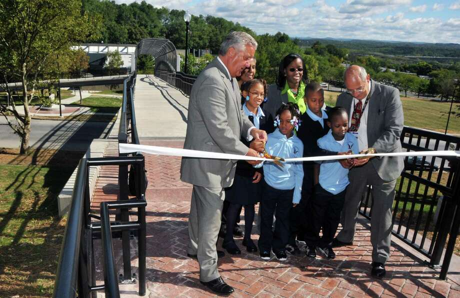 Mayor Jerry Jennings, left,  Arbor Hill Elementary students Tierra Watson, Journey Pierce, Amir Taylor,Jorsier Miller and Albany School District Superintendent Dr. Raymond Colucciello (at right) cut the ribbon to officially open the new $1.8 million Arbor Hill Pedestrian Bridge Wednesday morning September 15, 2010. Photo: John Carl D'Annibale, Times Union / 00010276A