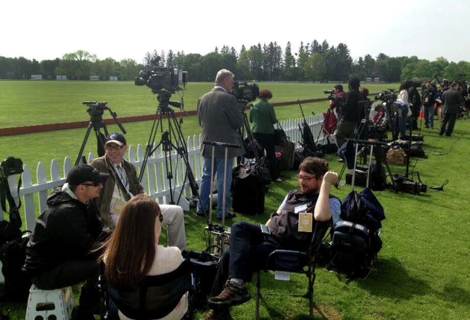 The media gathers at the Greenwich Polo Club, Wednesday, May 15, 2013 as they wait for Britain's Prince Harry who is playing in a charity match at the club. The match is raising funds for Sentebale, a charity Harry co-founded in 2006 in memory of his late mother, Princess Diana. Photo: Bob Luckey / Greenwich Time