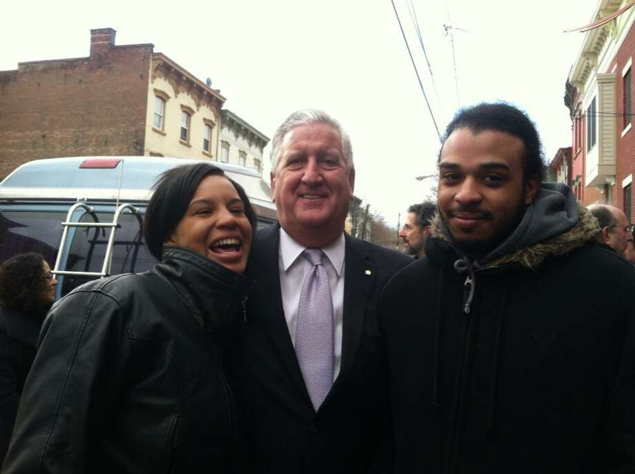 YouthBuild AmeriCorp Program students and staff with Mayor Jennings at the Habitat for Humanity unveiling in Albany earlier this year. 