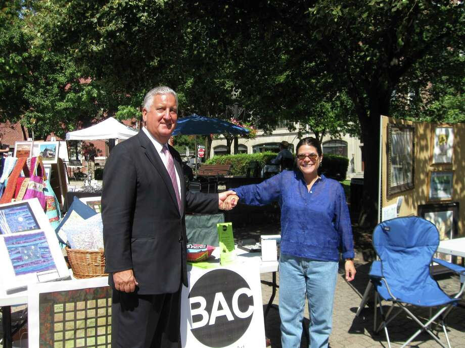 Susan Rivers and Mayor Jennings at an outdoor art fair in downtown Albany circa 2009.