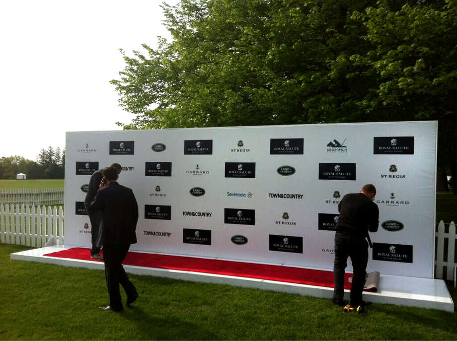 Workers set up stage area at the Greenwich Polo Club, Wednesday, May 15, 2013.Britain's Prince Harry is playing in a charity match at the club, raising funds for Sentebale, a charity Harry co-founded in 2006 in memory of his late mother, Princess Diana. Photo: Neil Vigdor / Greenwich Time