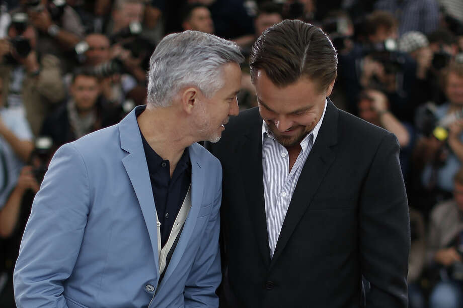 "Australian director Baz Luhrmann (L) talks to US actor Leonardo DiCaprio as they pose on May 15, 2013 during a photocall for their film ""The Great Gatsby"" ahead of the opening of the 66th edition of the Cannes Film Festival on May 15, 2013 in Cannes. Cannes, one of the world's top film festivals, opens on May 15 and will climax on May 26 with awards selected by a jury headed this year by Hollywood legend Steven Spielberg. Photo: VALERY HACHE, AFP/Getty Images / 2013 AFP"