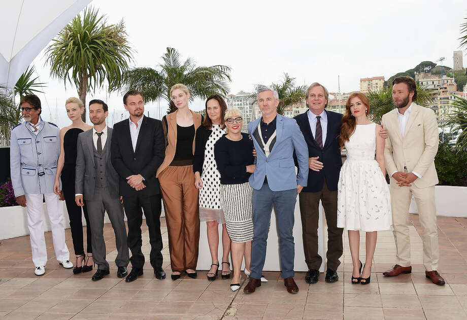 (L-R) Actors Amitabh Bachchan, Carey Mulligan, Tobey Maguire, Leonardo DiCaprio, Elizabeth Debicki, producer Lucy Fisher, production designer Catherine Martin, director Baz Luhrmann, producer Douglas Wick and actors Isla Fisher and Joel Edgerton attend the photocall for 'The Great Gatsby' at the 66th Annual Cannes Film Festival at Palais des Festivals on May 15, 2013 in Cannes, France. Photo: Dominique Charriau, WireImage / 2013 Dominique Charriau