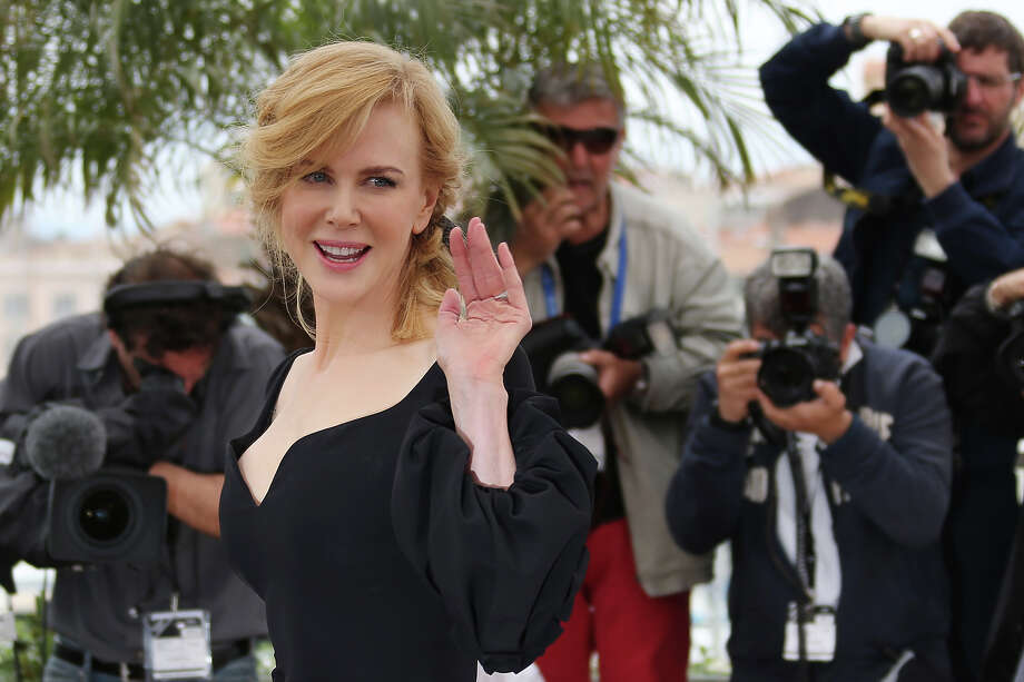 Australian actress and member of the Feature Film Jury Nicole Kidman waves on May 15, 2013 while posing during a photocall of the Feature Film Jury ahead of the opening of the 66th edition of the Cannes Film Festival on May 15, 2013 in Cannes. Cannes, one of the world's top film festivals, opens on May 15 and will climax on May 26 with awards selected by a jury headed this year by Hollywood legend Steven Spielberg. Photo: LOIC VENANCE, AFP/Getty Images / 2013 AFP