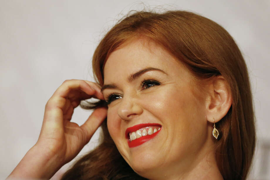 "British actress Isla Fisher smiles on May 15, 2013 while attending a press conference for ""The Great Gatsby"" ahead of the opening of the 66th edition of the Cannes Film Festival on May 15, 2013 in Cannes. Cannes, one of the world's top film festivals, opens on May 15 and will climax on May 26 with awards selected by a jury headed this year by Hollywood legend Steven Spielberg. Photo: LOIC VENANCE, AFP/Getty Images / 2013 AFP"