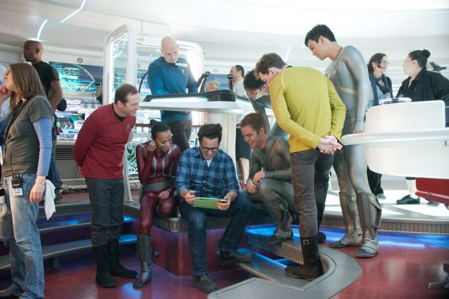 (From left to right) Simon Pegg, Zoe Saldana, J.J. Abrams, Chris Pine, Karl Urban, Anton Yelchin, and John Cho on the set of STAR TREK INTO DARKNESS from Paramount Pictures and Skydance Productions. Photo: Paramount Pictures,  Skydance Productions