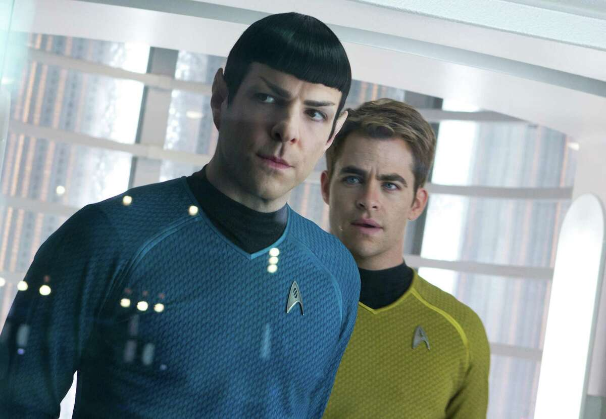 """This undated publicity film image released by Paramount Pictures shows, Zachary Quinto, left, as Spock and Chris Pine as Kirk in a scene in the movie, """"Star Trek Into Darkness,"""" from Paramount Pictures and Skydance Productions. (AP Photo/Paramount Pictures, Zade Rosenthal)"""