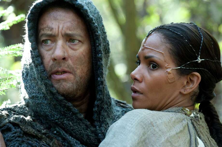 "This film image released by Warner Bros. Pictures shows Tom Hanks as Zachry and Halle Berry as Meronym in a scene from ""Cloud Atlas,"" an epic spanning centuries and genres. The film is an epic of shifting genres and intersecting souls that features Tom Hanks, Halle Berry, Jim Broadbent, Hugh Grant, Hugo Weaving, Ben Whishaw, Jim Sturgess, James DA'A'Arcy, Doona Bae, Keith David, Sarandon and others in multiple roles spanning the centuries. (AP Photo/Warner Bros. Pictures, Jay Maidment) Photo: Jay Maidment / Warner Bros. Pictures"