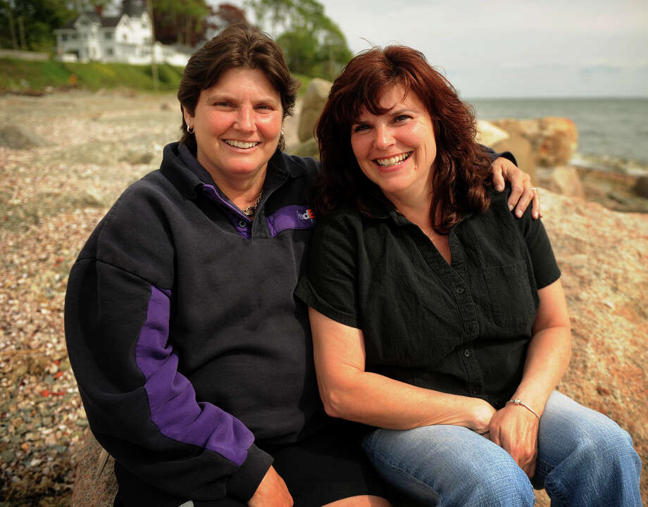 Sisters Brenda LaConte, left, and Bonnie McIlhoney, both of Stratford, at Gulf Beach in Milford, Conn. on Tuesday, May 14, 2013. LaConte had a double mastectomy after being diagnosed with breast cancer in 2009. McIlhoney, who carries the same gene, ultimately opted for the procedure because of her high cancer risk. Photo: Brian A. Pounds / Connecticut Post