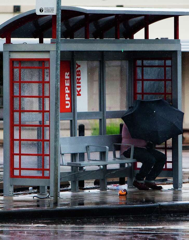 A man waits for the bus on Kirby Drive near Westheimer Road Wednesday, May 15, 2013, in Houston. (Cody Duty / Houston Chronicle)