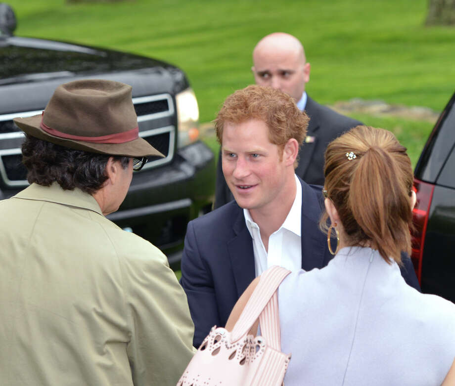 At center, Prince Harry arrives at the Greenwich Polo Club, Wednesday, May 15, 2013. At left is Peter Brant and at right is Brant's wife, Stephanie Seymour. The match is a fund-raiser for Sentebale, a charity Harry co-founded in 2006 in memory of his late mother, Princess Diana. Photo: Bob Luckey / Greenwich Time