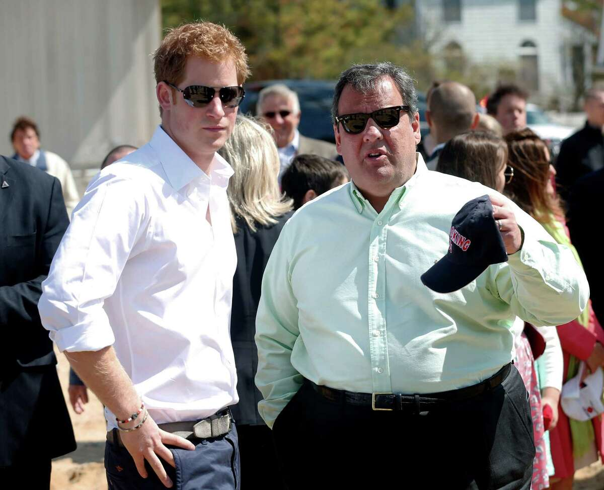 Britain's Prince Harry and N.J. Gov. Chris Christie talk during a visit to the area hit by Superstorm Sandy, Tuesday, May 14, 2013, in Mantoloking, N.J. Prince Harry began a tour of New JerseyÃ'Â's storm-damaged coastline, inspecting dune construction, walking past destroyed homes and shaking hands with police and other emergency workers. New Jersey sustained about $37 billion worth of damage from the storm.