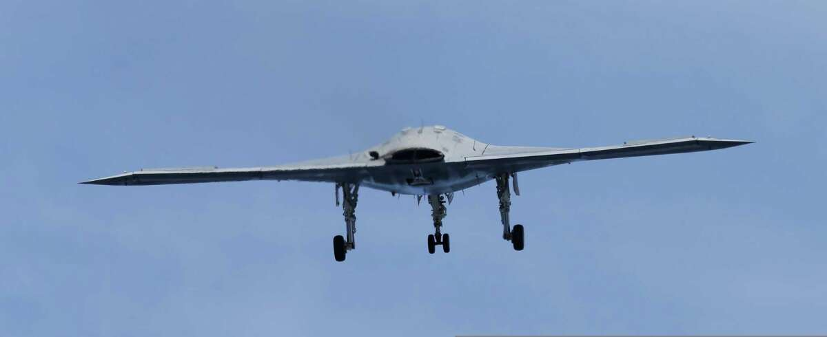 A Navy X-47B drone does a fly buy the nuclear powered aircraft carrier USS George H. W. Bush after it was launched off the coast of Virginia, Tuesday, May 14, 2013. The plane isn't intended for operational use, but it will be used to help develop other unmanned, carrier-based aircraft.