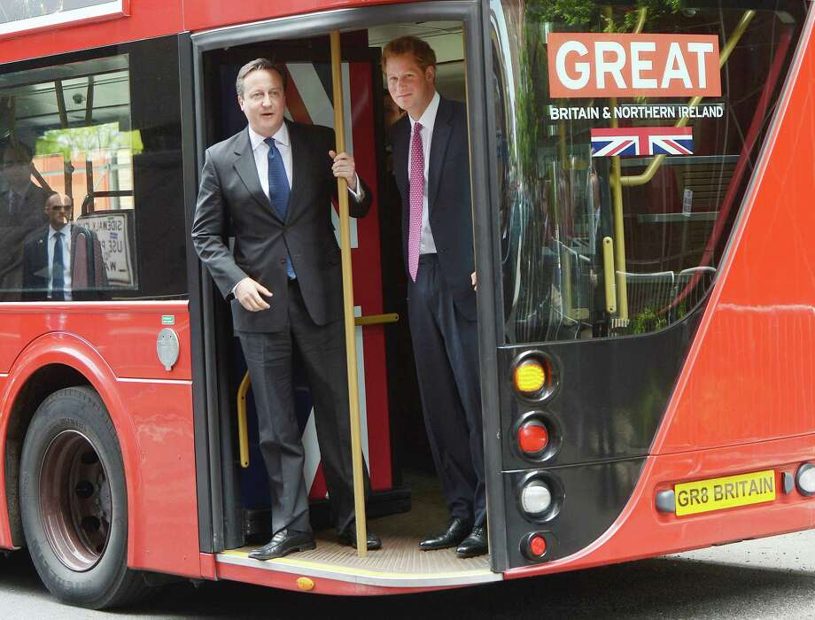 Britain's Prince Harry(R) and British Prime Minister David Cameron arrive at Milk Studio aboard a double decker bus in New York, May 14, 2013. AFP PHOTO/Emmanuel DuandEMMANUEL DUNAND/AFP/Getty Images Photo: EMMANUEL DUNAND, AFP/Getty Images / AFP