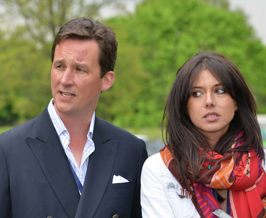 At left, Torquhil Ian Campbell, the 13th Duke of Argyll, and an unidentified woman at the Greenwich Polo Club, Wednesday, May 15, 2013. The match is a fund-raiser for Sentebale, a charity Prince Harry co-founded in 2006 in memory of his late mother, Princess Diana. Photo: Bob Luckey / Greenwich Time