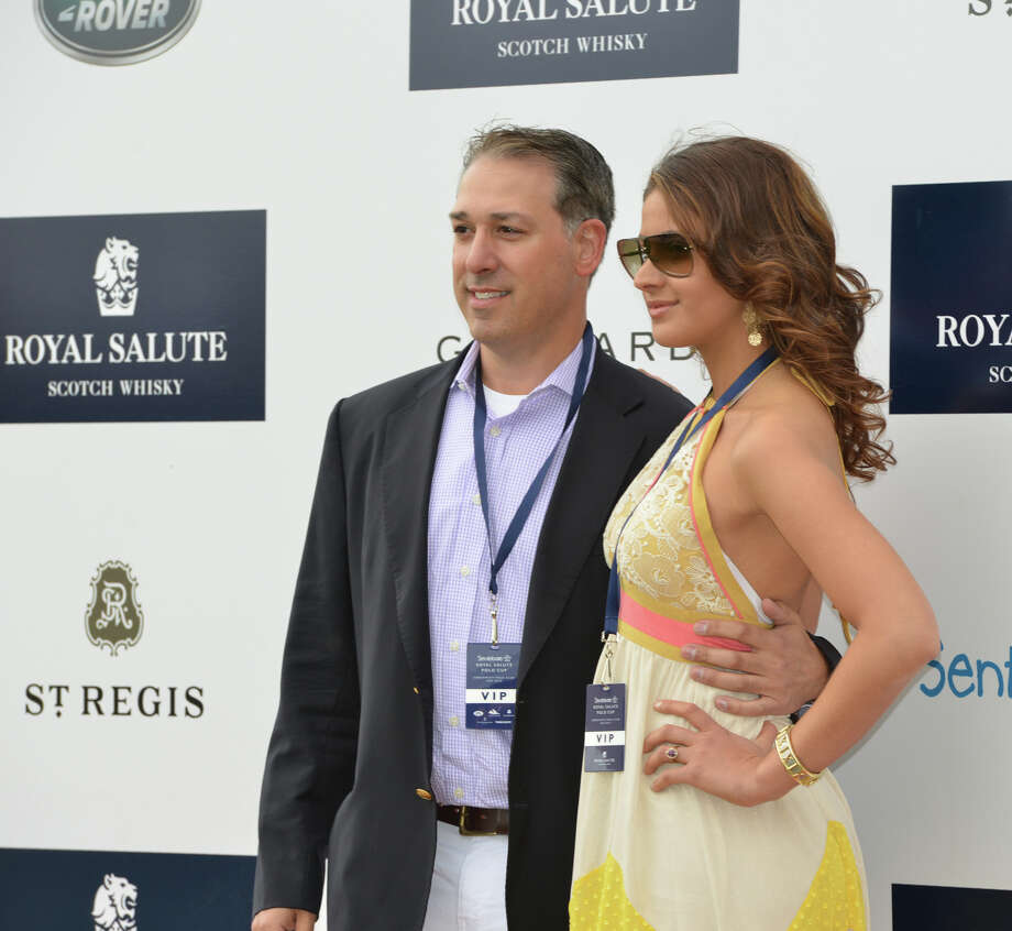 Michael Carrazza, left, and Cynthia Jorge, both of New York City, during the the Sentebale Polo Cup festivitiesat the Greenwich Polo Club, Wednesday, May 15, 2013. The match is a fund-raiser for Sentebale, a charity Prince Harry co-founded in 2006 in memory of his late mother, Princess Diana. Photo: Bob Luckey / Greenwich Time