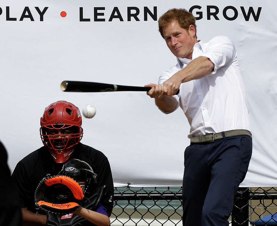 Britain's Prince Harry hits a ball pitched to him by New York Yankees first baseman Mark Teixeira during a visit to Harlem RBI's baseball program in New York, Tuesday, May 14, 2013, to launch a partnership between the organization, the Royal Foundation of the Duke and Duchess of Cambridge, and Prince Harry. Photo: Kathy Willens, AP / AP