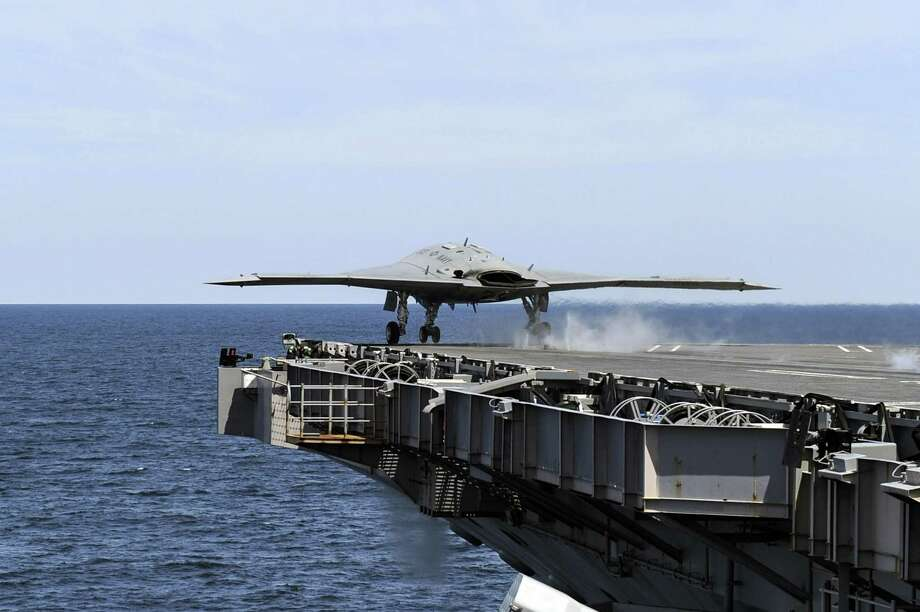 ATLANTIC OCEAN - MAY 14:  In this handout released by the U.S. Navy courtesy of Northrop Grumman, an X-47B Unmanned Combat Air System (UCAS) demonstrator launches from the aircraft carrier USS George H.W. Bush (CVN 77) May 14, 2013 in the Atlantic Ocean. George H.W. Bush is the first aircraft carrier to successfully catapult-launch an unmanned aircraft from its flight deck. The Navy plans to have unmanned aircraft on each of its carriers to be used for surveillance and be armed and used in combat roles. Photo: U.S. Navy, Getty Images / 2013 U.S. Navy