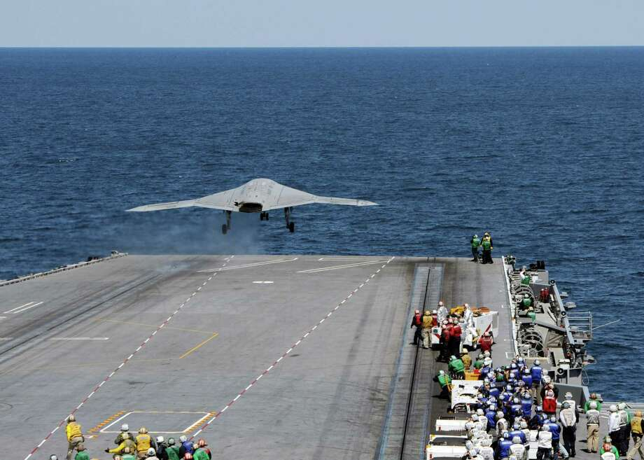 ATLANTIC OCEAN - MAY 14:  In this handout released by the U.S. Navy, An X-47B Unmanned Combat Air System (UCAS) demonstrator launches from the flight deck of the aircraft carrier USS George H.W. Bush (CVN 77) May 14, 2013 in the Atlantic Ocean. George H.W. Bush is the first aircraft carrier to sucessfully catapult-launch an unmanned aircraft from its flight deck. The Navy plans to have unmanned aircraft on each of its carriers to be used for surveillance and be armed and used in combat roles. Photo: U.S. Navy, Getty Images / 2013 U.S. Navy