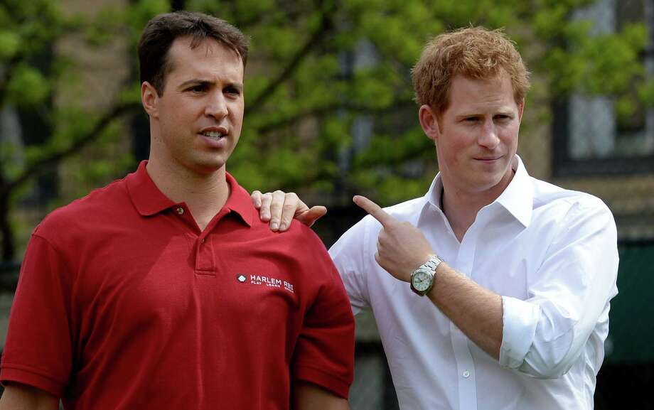 Britain's Prince Harry, right, points toward New York Yankees baseball player Mark Texeria while participating in a baseball clinic during the launch of a new partnership between the Royal Foundation of the Duke and Duchess of Cambridge and Harlem RBI, a local community organization, in New York, Tuesday, May 14, 2013.  Prince Harry is in the midst of weeklong visit to the United States. Photo: Justin Lane, AP / EPA POOL