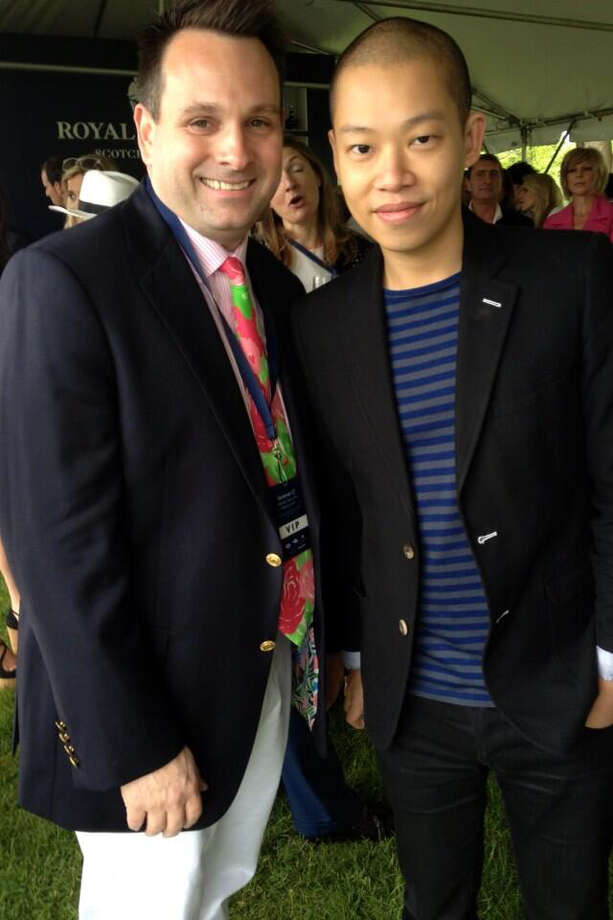 Greenwich Selectman Drew Marzullo snags a photo with designer Jason Wu at the Greenwich Polo Club, Wednesday, May 15, 2013 for a benefit match featuring Prince Harry. The event is to raise funds for Sentebale, a charity co-founded  by Britain's Prince Harry in 2006 in memory of his late mother, Princess Diana. Photo: Neil Vigdor / Greenwich Time