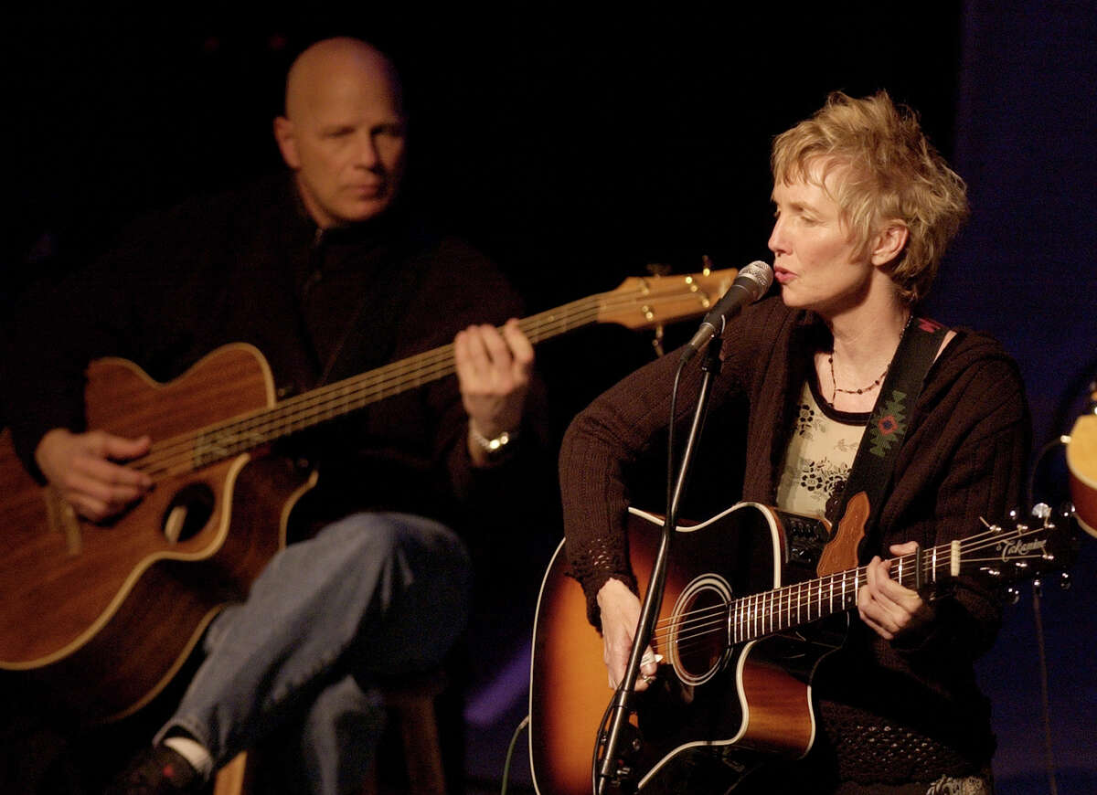 Eliza Gilkyson performs, with Glenn Schuetz, during a tribute concert for Woody Guthrie at the Crighton Theater Sunday, Feb. 16, 2003, in Conroe, Texas. (Photo by Brett Coomer/Special to the Chronicle)