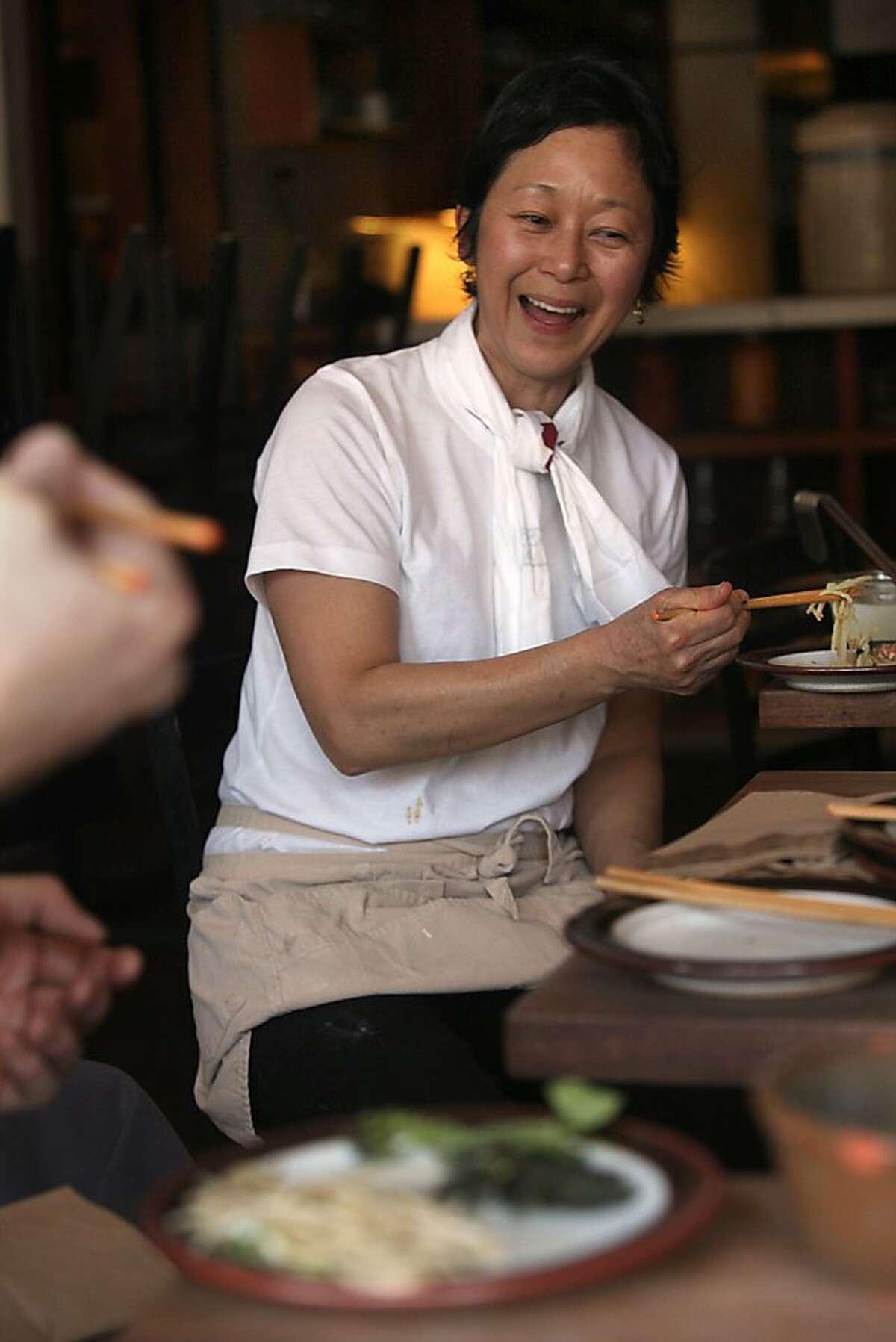 Artisan food purveyor Sonoko Sakai tastes her dish at Bar Tartine in San Francisco, California, on Tuesday, April 30, 2013. She is meeting with Bar Tartine chefs to finalize a menu for a Koji dinner later in May. Shio Koji is a newly popular seasoning in Japan.