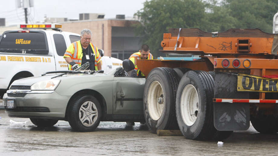 Emergency crews work to clear the scene on I-610 about 10:30 a.m. Wednesday. Photo: (Cody Duty / Houston Chronicle)